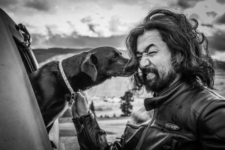 hairy Asian man with dog